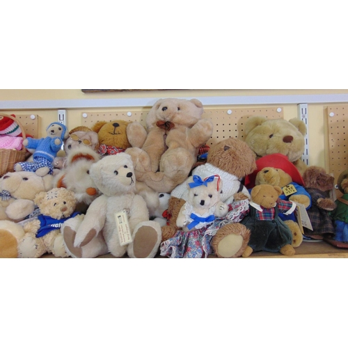 A extensive collection of mixed teddy bears, some Woodrow Bears, including one in a sailors outfit, (one shelf)