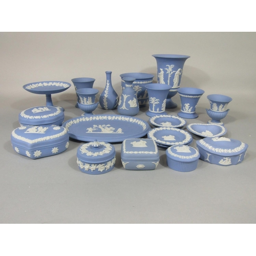 1037 - A collection of Wedgwood blue ground Jasperwares including comport, nine vases of various shape, tri...