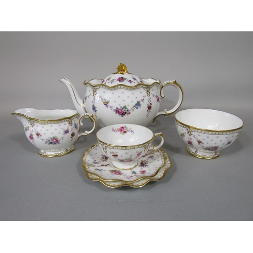 1039 - A collection of Royal Crown Derby Royal Antoinette pattern tea wares comprising teapot and cover, pa...