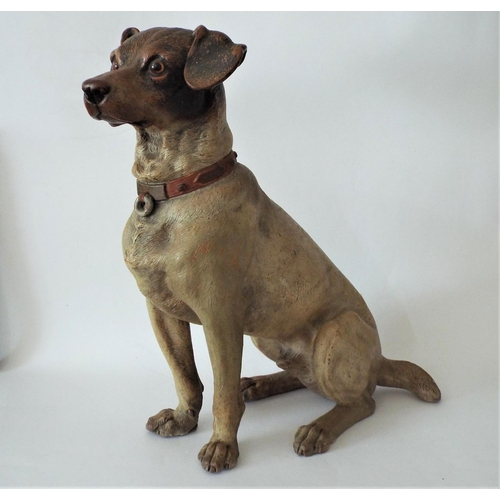115 - A good late 19th century terracotta model of a seated terrier, with original naturalistic painted fi...