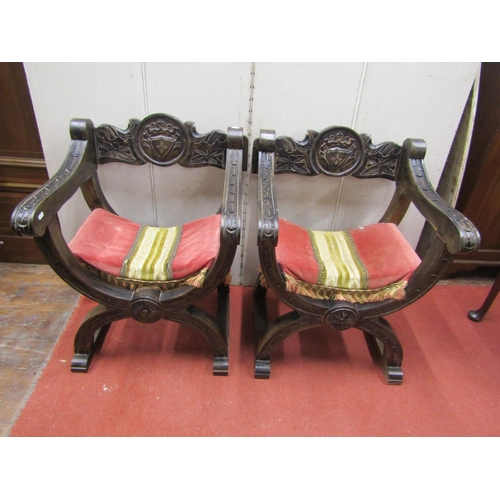 2526 - A pair of continental X framed chairs with carved finish...