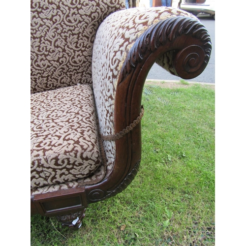 2527 - A Regency scroll end sofa, showwood frame with acanthus and other detail, raised on four carved and ...