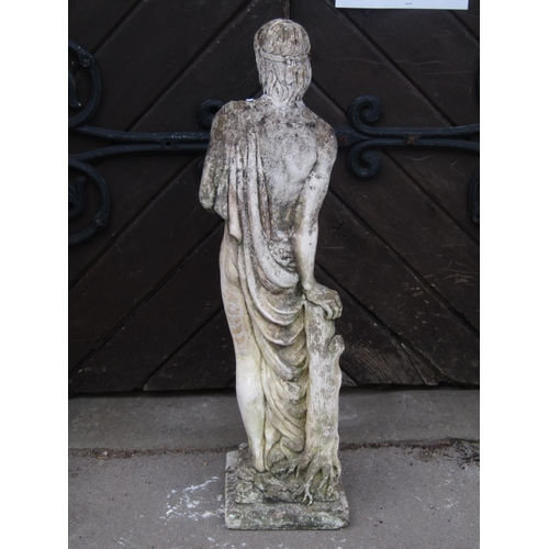 2096 - A weathered cast composition stone classical male garden figure/statue in standing pose beside and l...