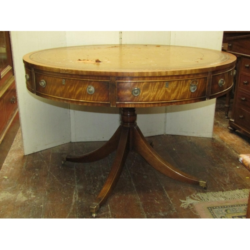 2661 - A Georgian style drum table, the circular top enclosing four real and four dummy drawers, brass ring...