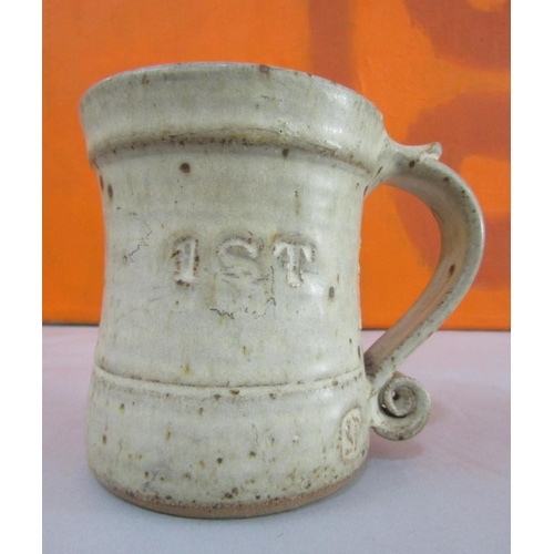 1 - John Maltby for Stoneshill Pottery studio pottery tankard of waisted form with S scroll handle, inci...