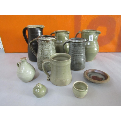 13 - Probably Leach of St Ives - A collection of mainly celadon glazed studio pottery comprising five jug...
