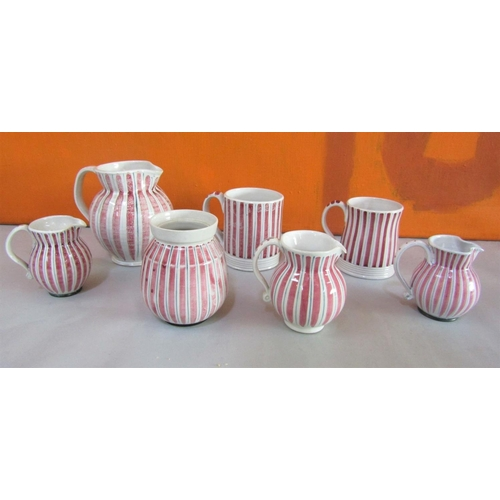 19 - Rye design team for Rye pottery cottage stripe collection comprising four jugs, two mugs and a prese...