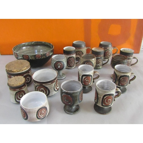 31 - Briglin Pottery - A large collection of studio pottery comprising fruit bowls, preserve pots, goblet...