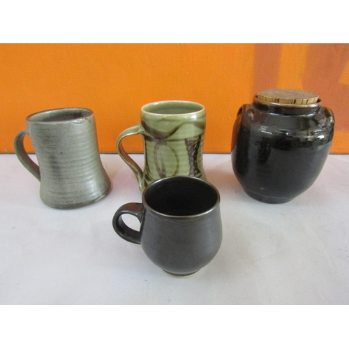 36 - Harry Davis & May for Crowan Pottery two celadon glazed pint tankards together with a further brown ...