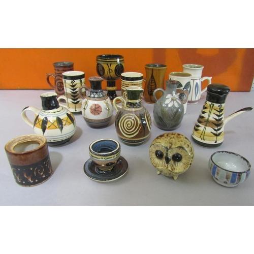 44 - Stuart Bass studio pottery collection comprising various jugs, goblets, vases, etc (16)...