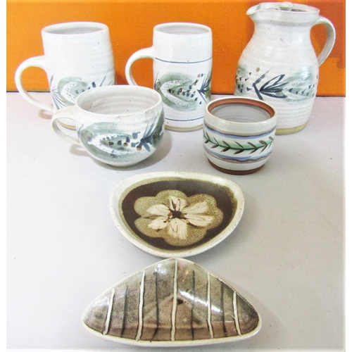 46 - Marianne De Trey - Collection of stoneware studio pottery comprising two tankards, mug and jug all w...