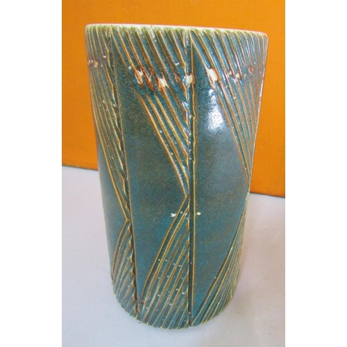 52 - Interesting Poole Pottery cylinder vase with green over glaze and incised geometric decoration, 23cm...