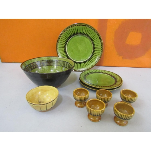 57 - Collection of Coldstone pottery comprising three plates, five egg cups and a dish all with similar d...