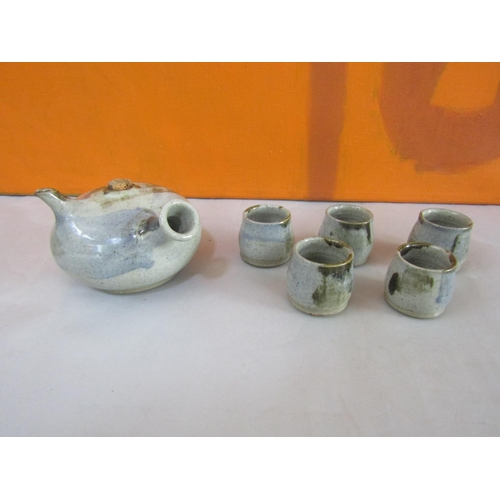 8 - St Ives Pottery Saki/rice wine tea service comprising stylised ovoid tea pot and six celadon glazed ...