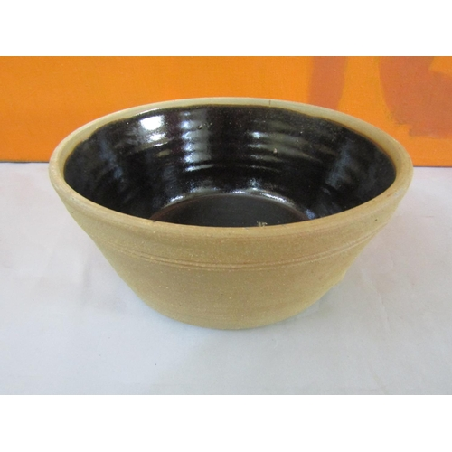 9 - Possibly by Bernard Leach - St Ives Pottery fruit or dairy bowl, with brown glazed interior, 30cm di...
