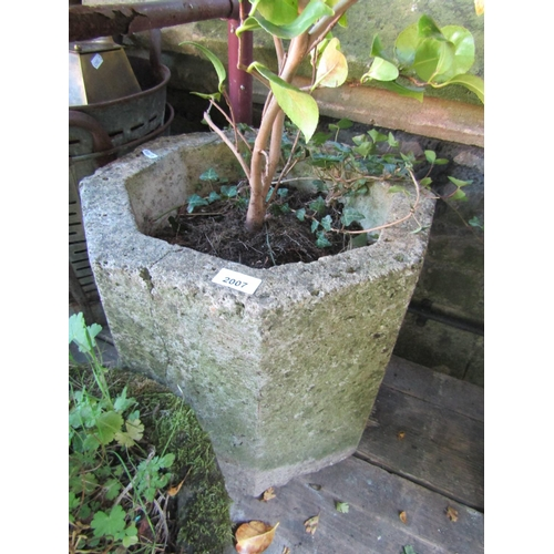 2003 - A weathered natural stone trough/planter of circular form 38 cm in diameter x 24 cm in height, toget...