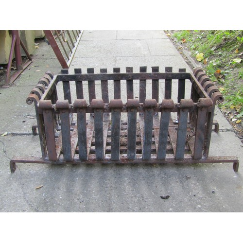 2018 - A cast iron fire basket with concave trellis front together with one other of varying design (AF)...
