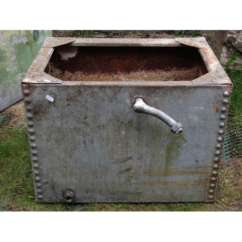 2035 - A reclaimed heavy gauge galvanised steel water tank of rectangular form with riveted seams and small...