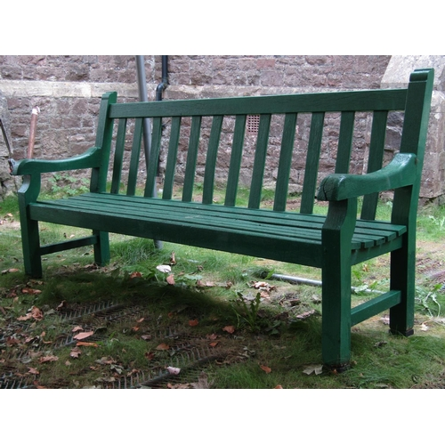 2042 - A substantial teak/possibly oak, green painted garden bench with slatted seat and back, 2 metres lon...