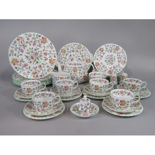 1023 - A collection of Minton Haddon Hall pattern wares comprising teapot, milk jug, sugar bowl, six cups, ...
