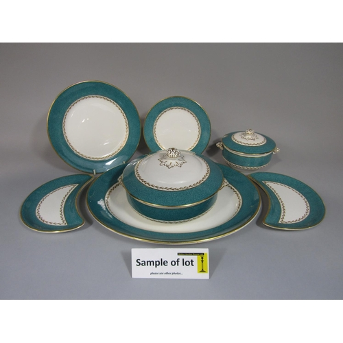 1001 - A collection of dinnerwares retailed by T Goode & Co of London, with speckled teal coloured border a...