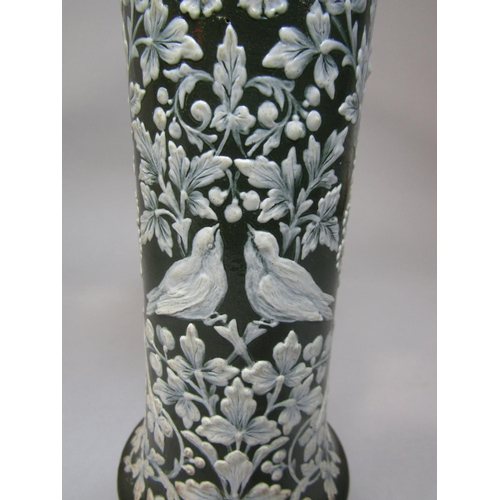 1006 - An unusual Royal Doulton vase of cylindrical form with flared neck and with moulded and painted pate...