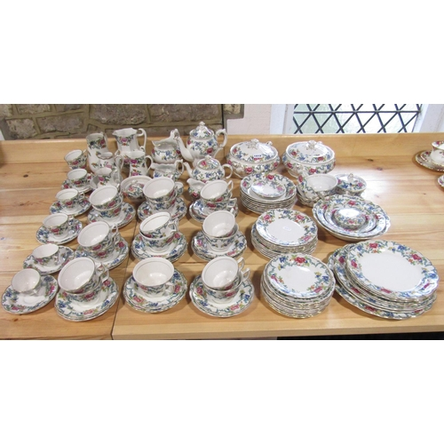 1012 - A collection of Booths Floradora pattern wares to include a pair of tureens and covers, coffee pot, ...