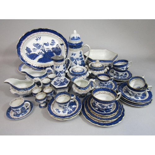 1015 - A collection of Booths Real Old Willow pattern blue and white printed wares comprising a bowl of hex...