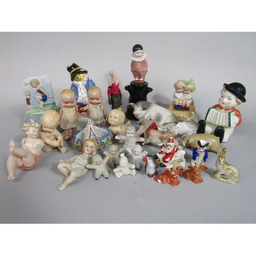 1020 - A collection of mainly early to mid-20th century novelty cake ornaments including Snow Babies, Fathe...