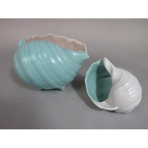 1021 - A collection of Poole Pottery vases in the form of shells with various glazed finishes, together wit...