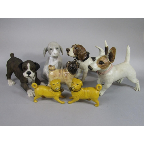 1022 - A collection of ceramic models of dogs including a pair of late 19th century yellow glazed models of...