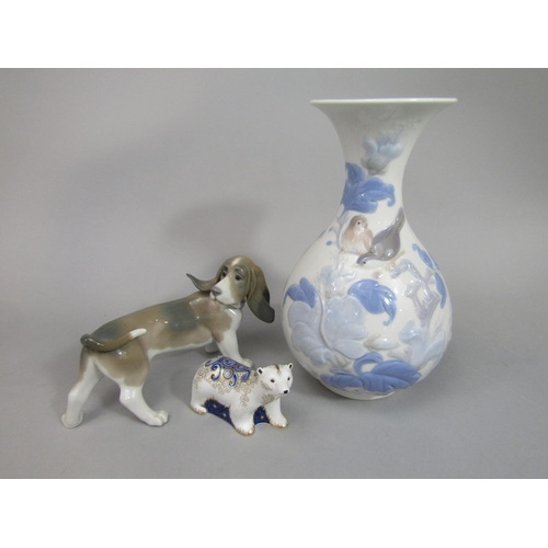 1033 - A Lladro model of a Bassett Hound chasing its tail, 21cm long approx, together with a Lladro vase wi...