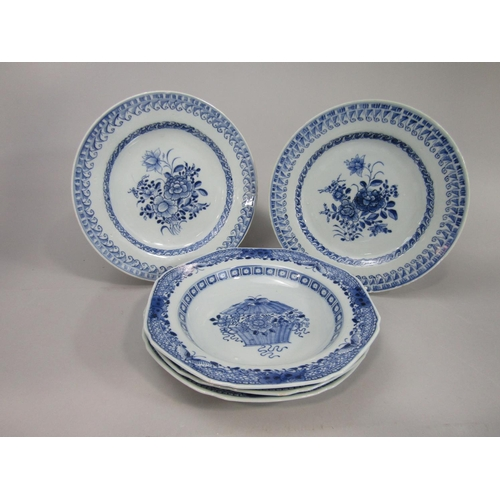 1046 - A set of three 19th century oriental blue and white dishes with painted flower basket decoration wit...