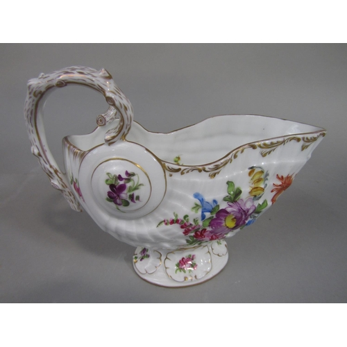 1050 - A 19th century continental sauce boat in the 18th century manner, modelled as a shell with divided r...