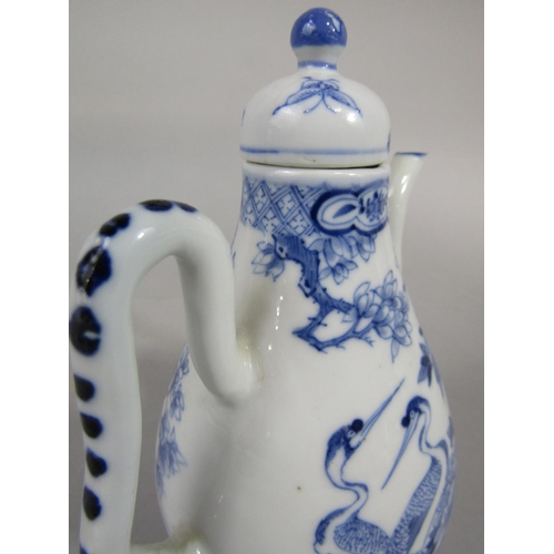 1051 - A 19th century oriental coffee pot with painted blue and white exotic bird decoration with painted b...