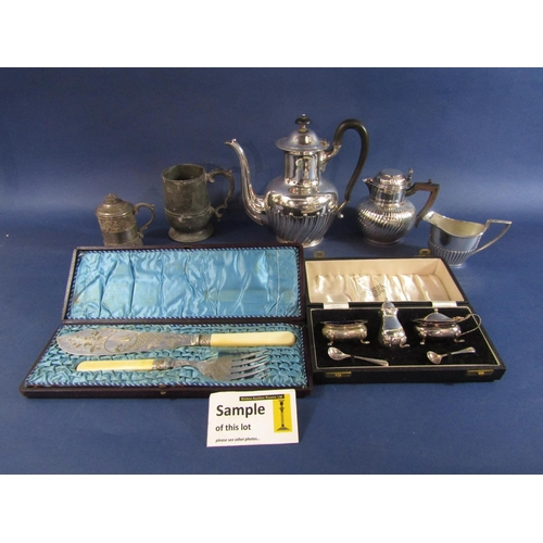 Interesting white metal christening cup with embossed banded decoration, together with a further fluted teapot, various further silver plated teawares together with a large collection of silver plated flatware, entrée dishes, etc