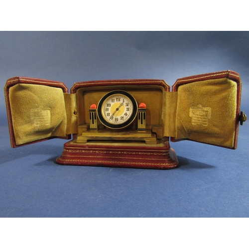 1435 - Fine Cartier boudoir/cabinet clock, the brass case with inset black enamel, the dial with gilt paint...