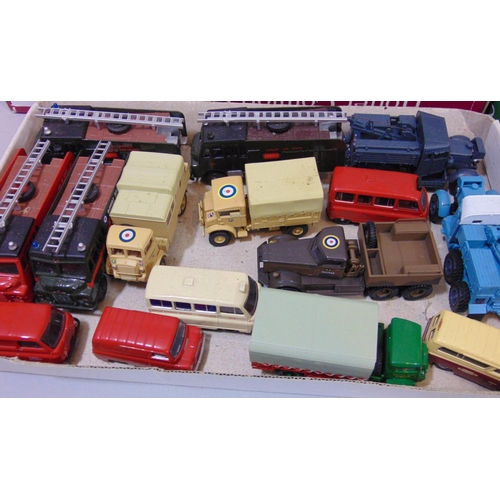 23 - A large collection of Oxford Model vehicles including military vehicles, fire engines and buses, mos...