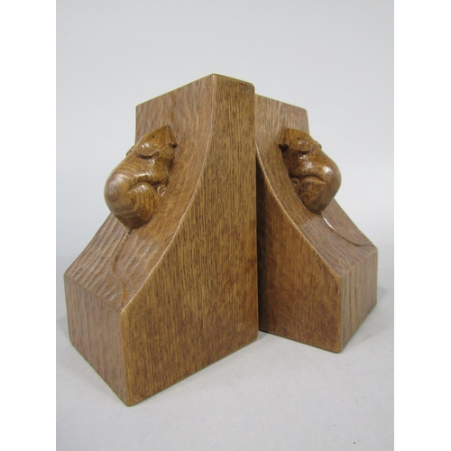 Pair of Robert Mouseman Thompson carved oak bookends with typical mouse decoration and scalloped edges, 16 cm high (2)