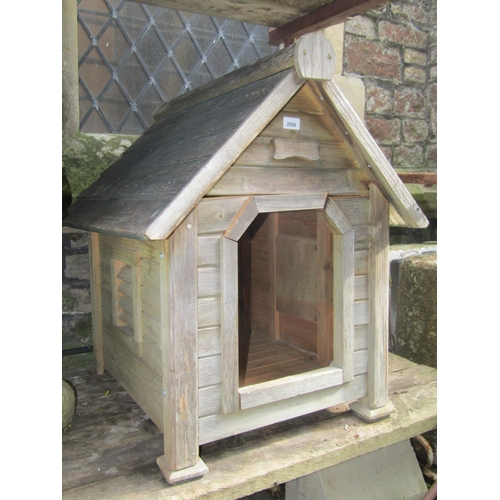 2006 - A weathered wooden tongue and groove panelled dog kennel with fixed louvre side vents, 72 cm long x ...