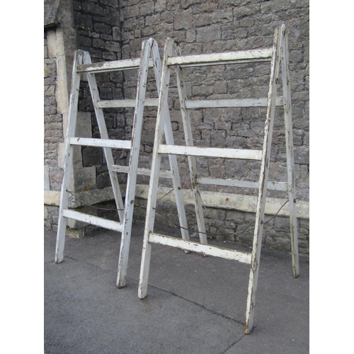 2019 - A pair of vintage painted pine folding trestles 83 cm wide x 185 cm in height (closed)...