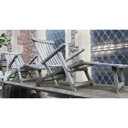 2020 - A pair of weathered contemporary teak folding steamer type garden armchairs with slatted seats, back...