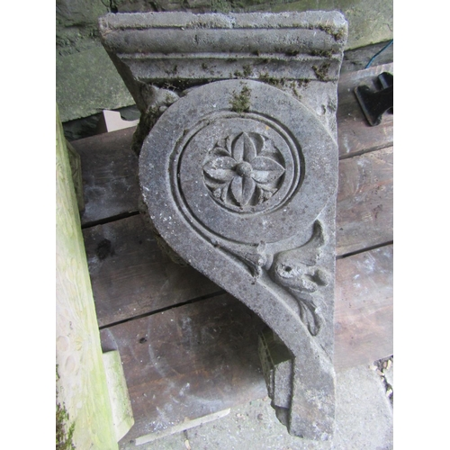 2024 - A weathered composition stone corbel/water feature with well defined face mask, Greek key and floral...