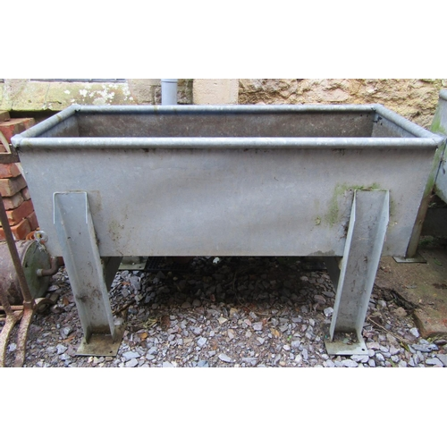 2036 - A galvanised trough/planter of rectangular form with rounded edge, raised on removable supports. 125...