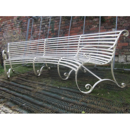 2041 - A good quality sprung steel and strap work cream painted garden bench of unusual curved form with op...
