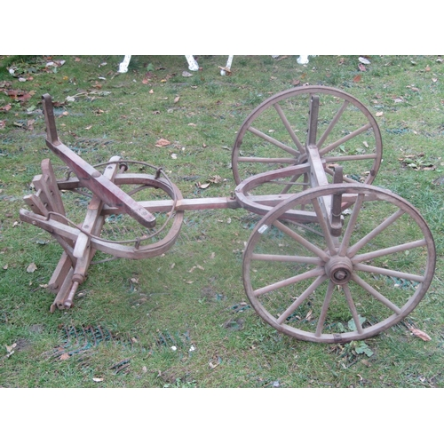 2043 - A small vintage wooden hand cart chassis with spoke wheels and iron rims...
