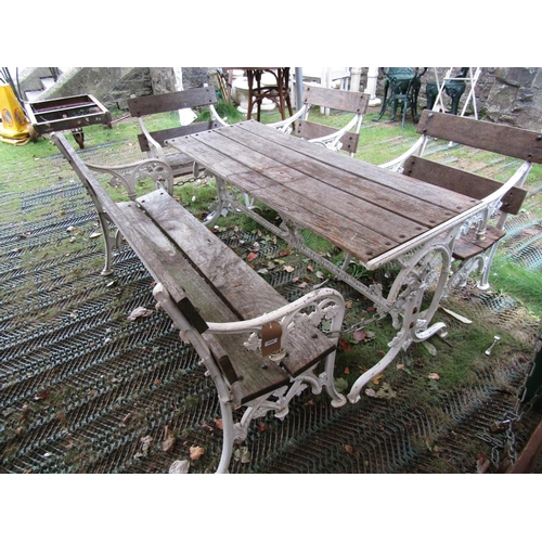 2046 - A good quality five piece garden suite in the Coalbrookdale manner, comprising rectangular table, be...