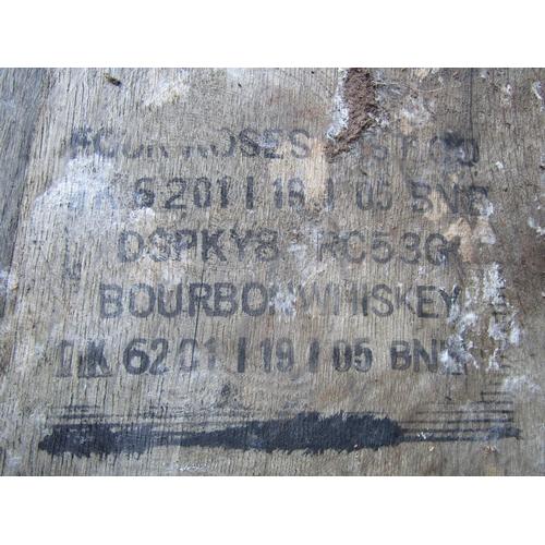 2047 - A coopered oak and steel banded bourbon whisky barrel, 88 cm high...