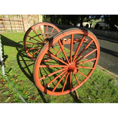 2050 - A pair of 19th century horse carriage/trap wheels and combined axle and springs with iron hubs, 16 s...