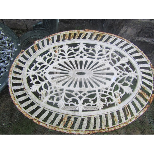 2052 - A cast aluminium garden terrace table of circular form with decorative pierced top and weathered gre...